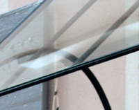 M03 - Marquise en fer forgé pour une porte d'entrée à Annonay (07)