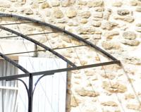 TP05 — Tonnelle en fer forgé ajusté et adapté à la maçonnerie dissymétrique Saillans (26)
