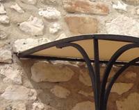 TP06 — Tonnelle en fer forgé sur bar d'extérieur